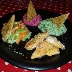 Breaded chicken with broccoli and beetroot dip and herb bread